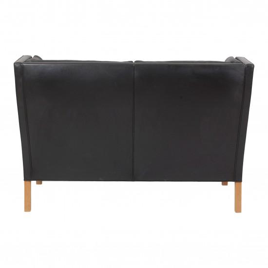 Børge Mogensen 2.pers Kupe sofa i originalt patineret sort læder samt ben af eg